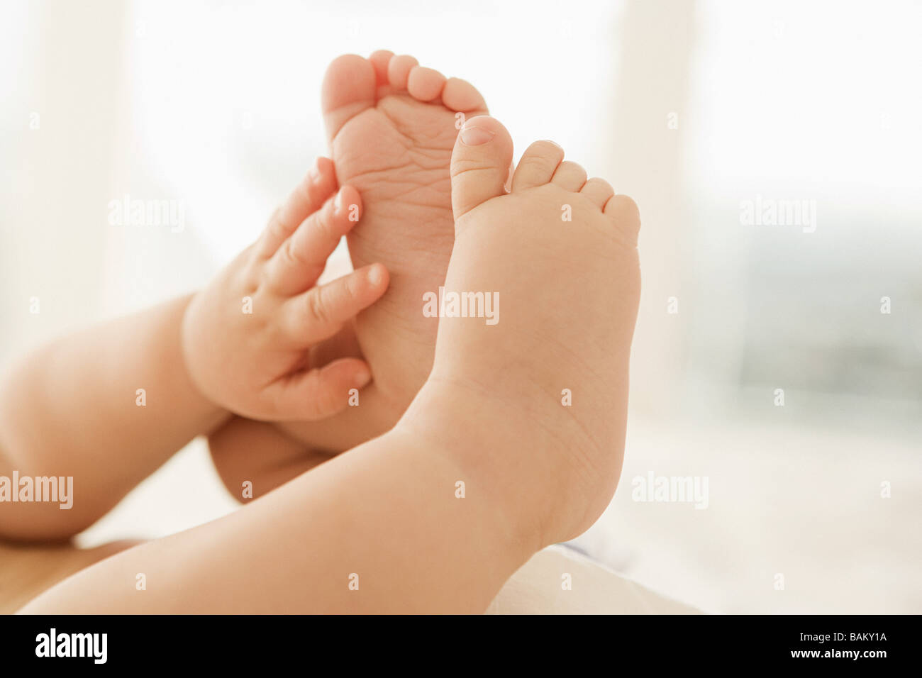 Babys hands and feet - Stock Image