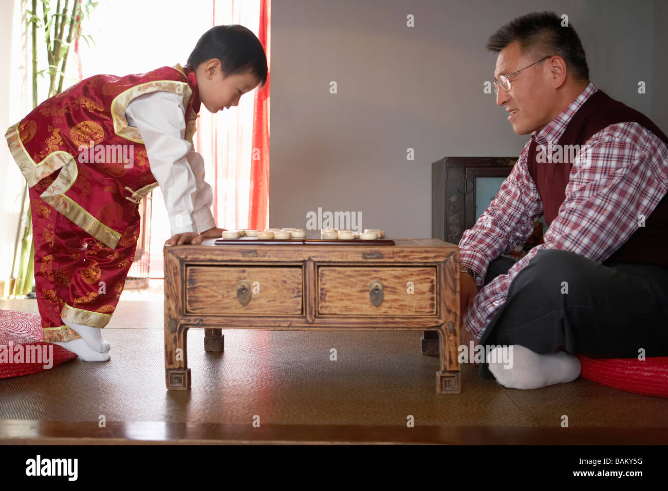 Grandfather And Grandson Playing Chinese Chess - Stock Image