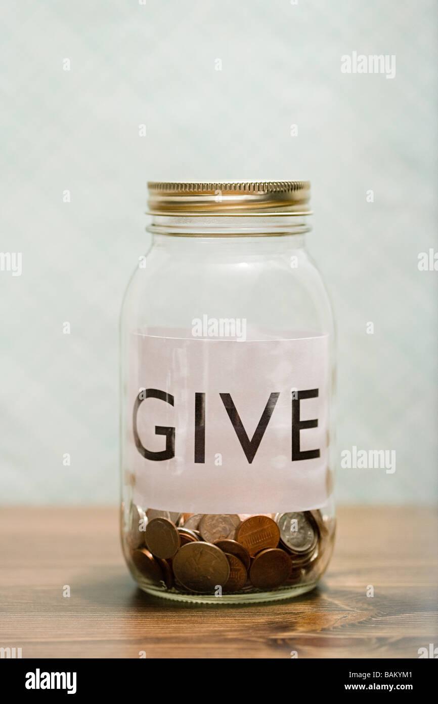 Charity jar - Stock Image