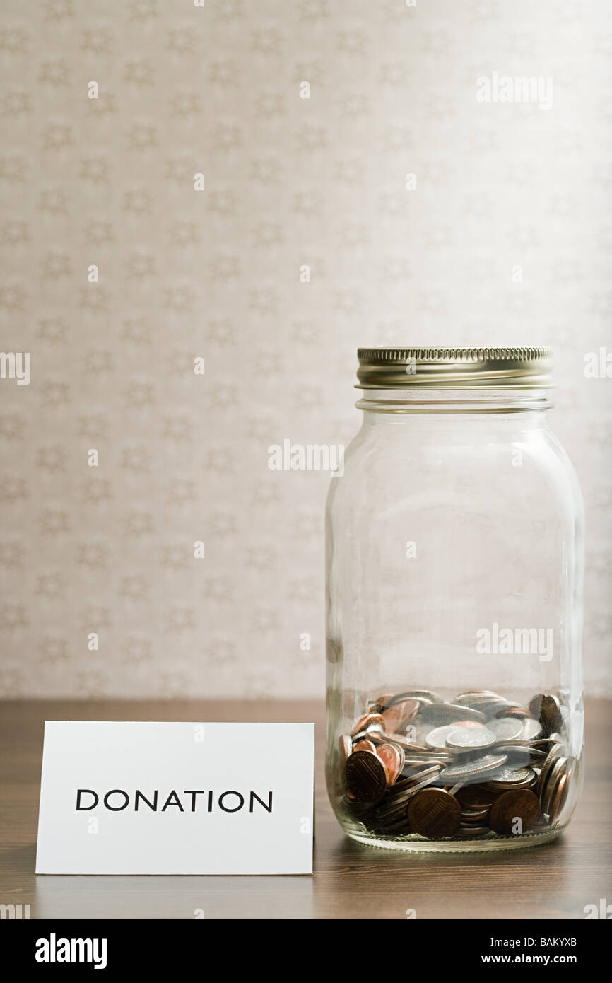 Donation jar - Stock Image