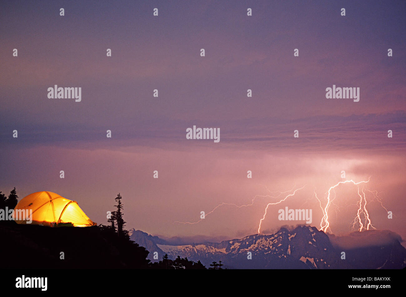 Lightning storm and tent at sloan peak - Stock Image