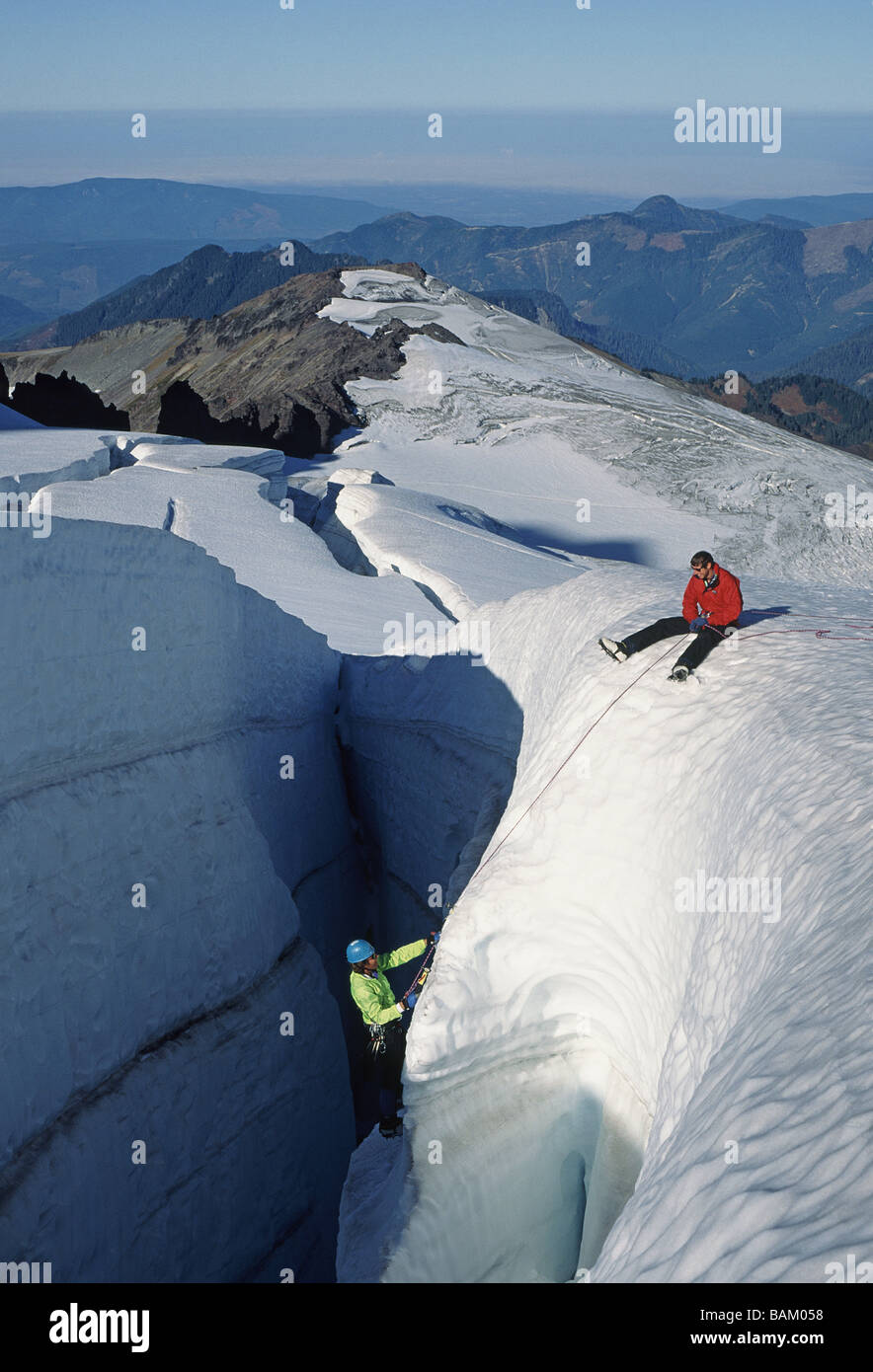 Climbers on crevasse wall at coleman glacier - Stock Image