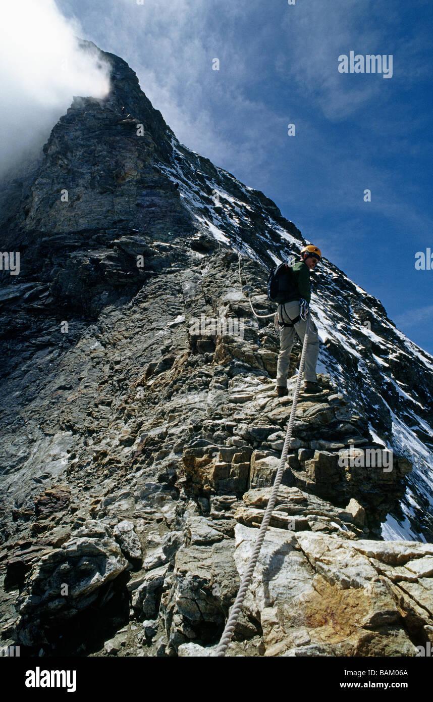 Climber descending hornli ridge on matterhorn - Stock Image