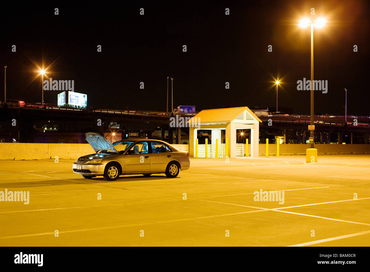 Broken down car in parking lot Stock Photo
