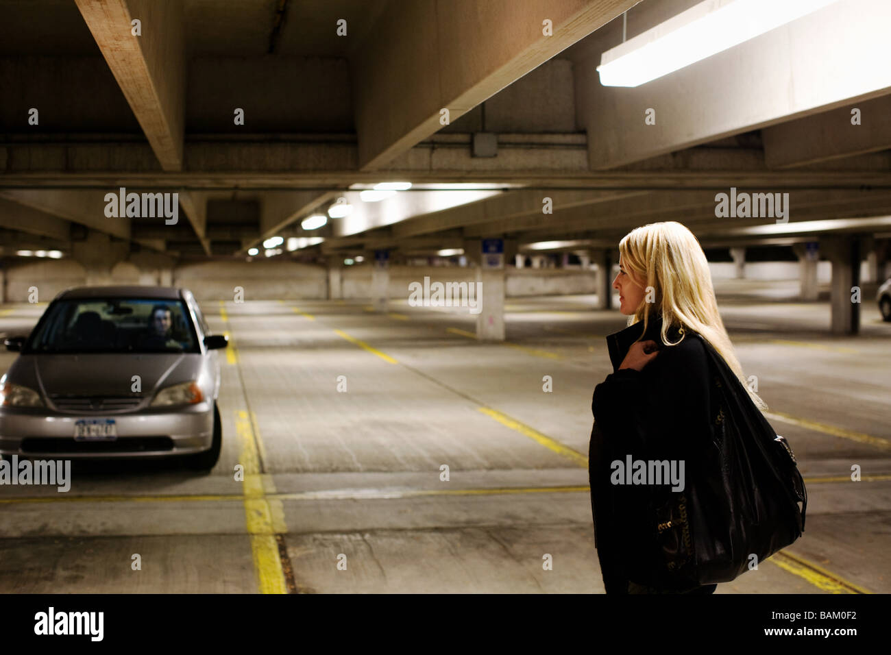 Woman in parking lot - Stock Image