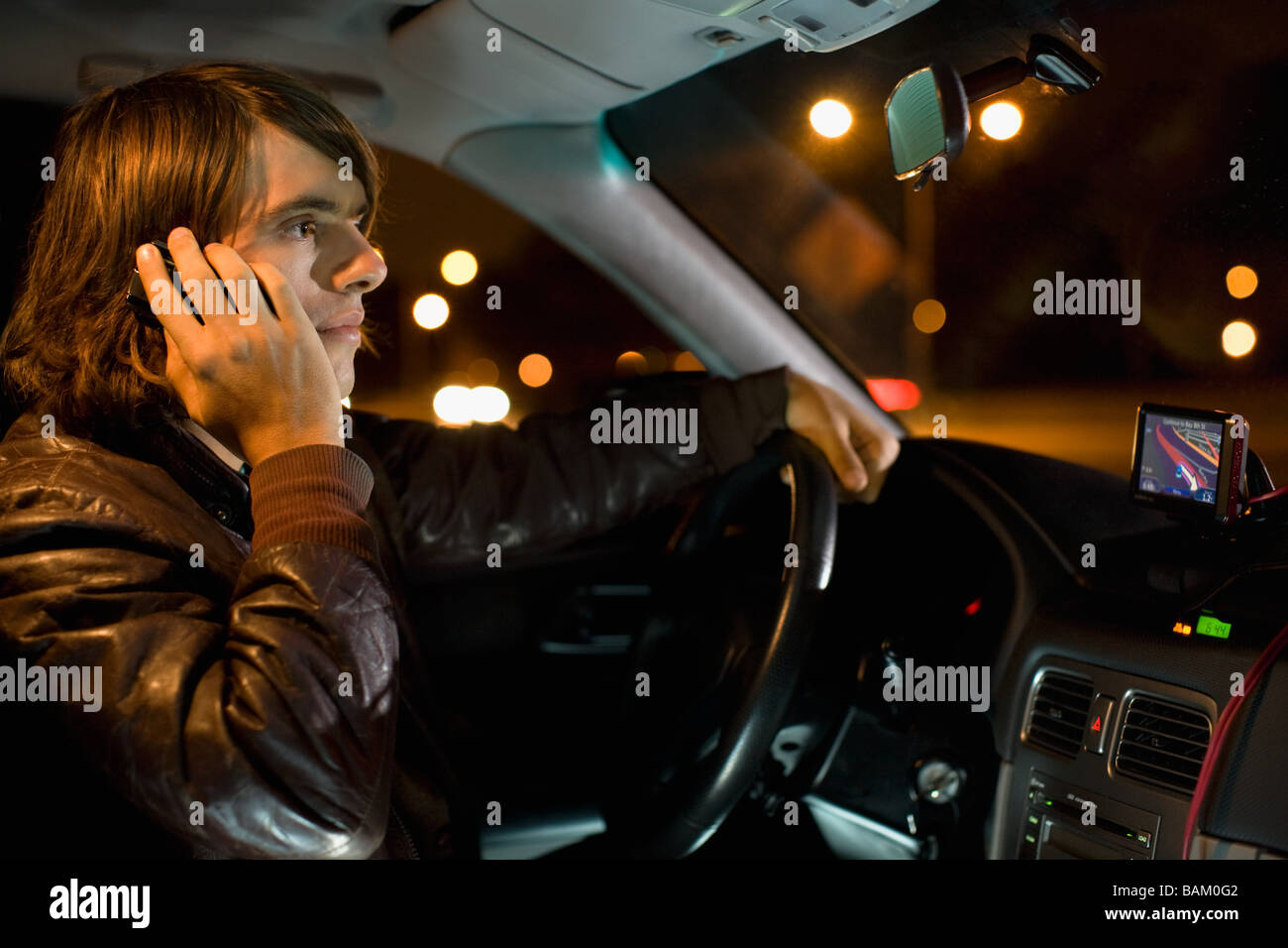 Man on cellphone in car - Stock Image