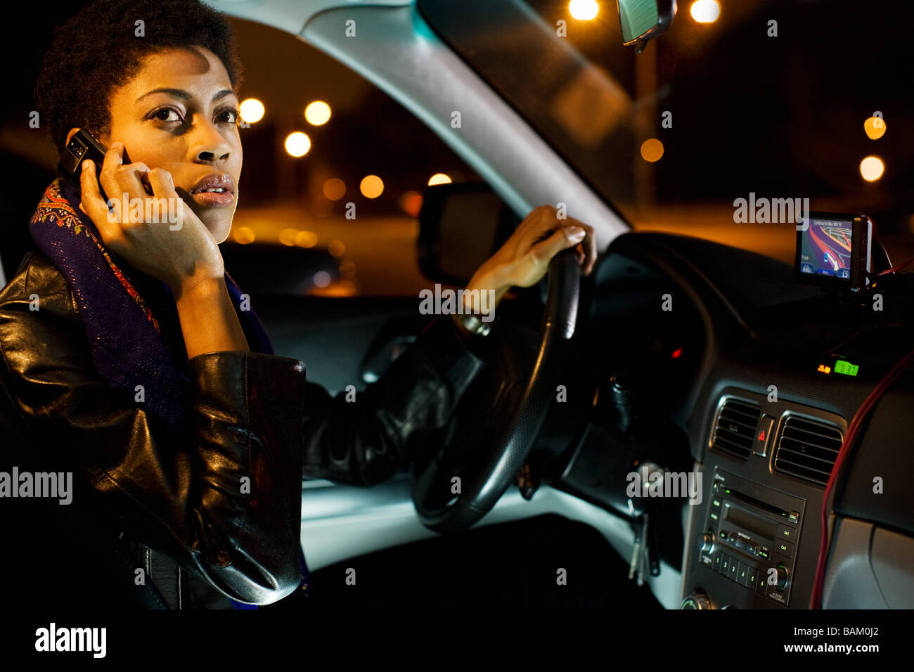 Woman on cellphone in car - Stock Image