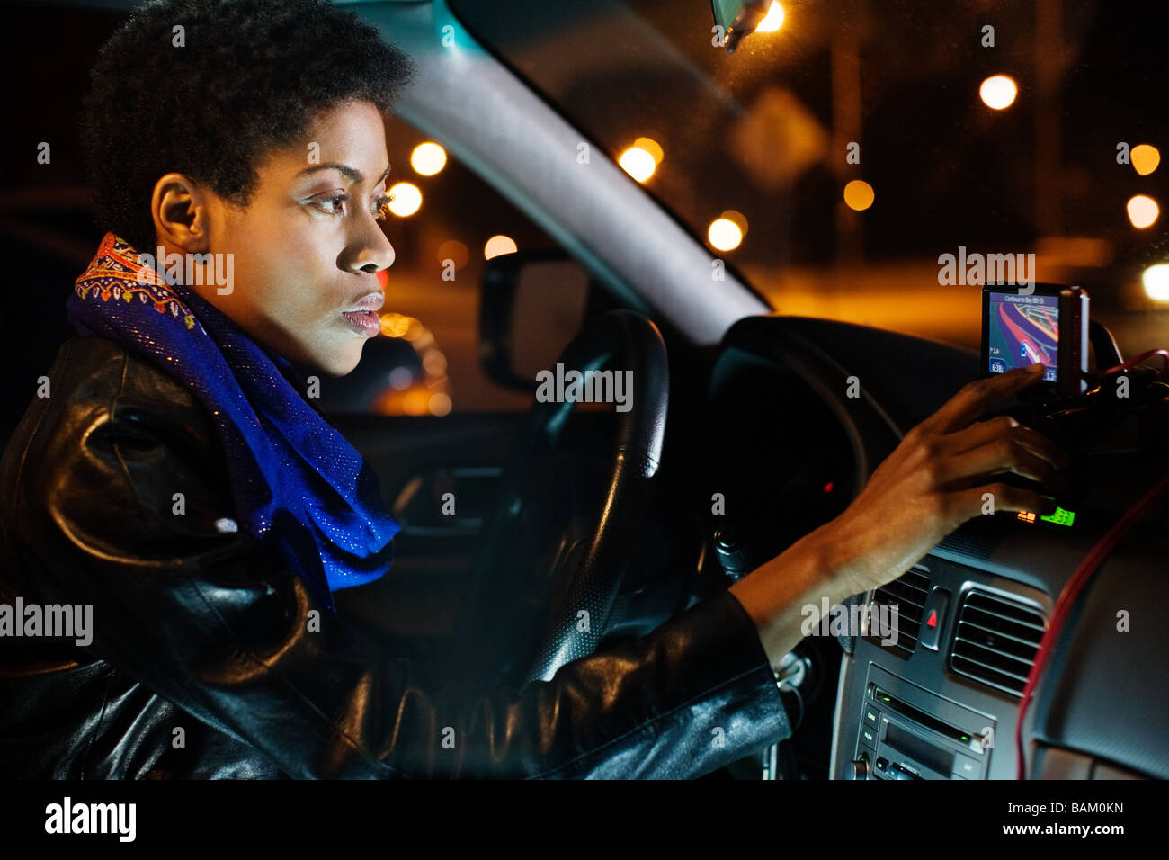 Woman using sat nav - Stock Image