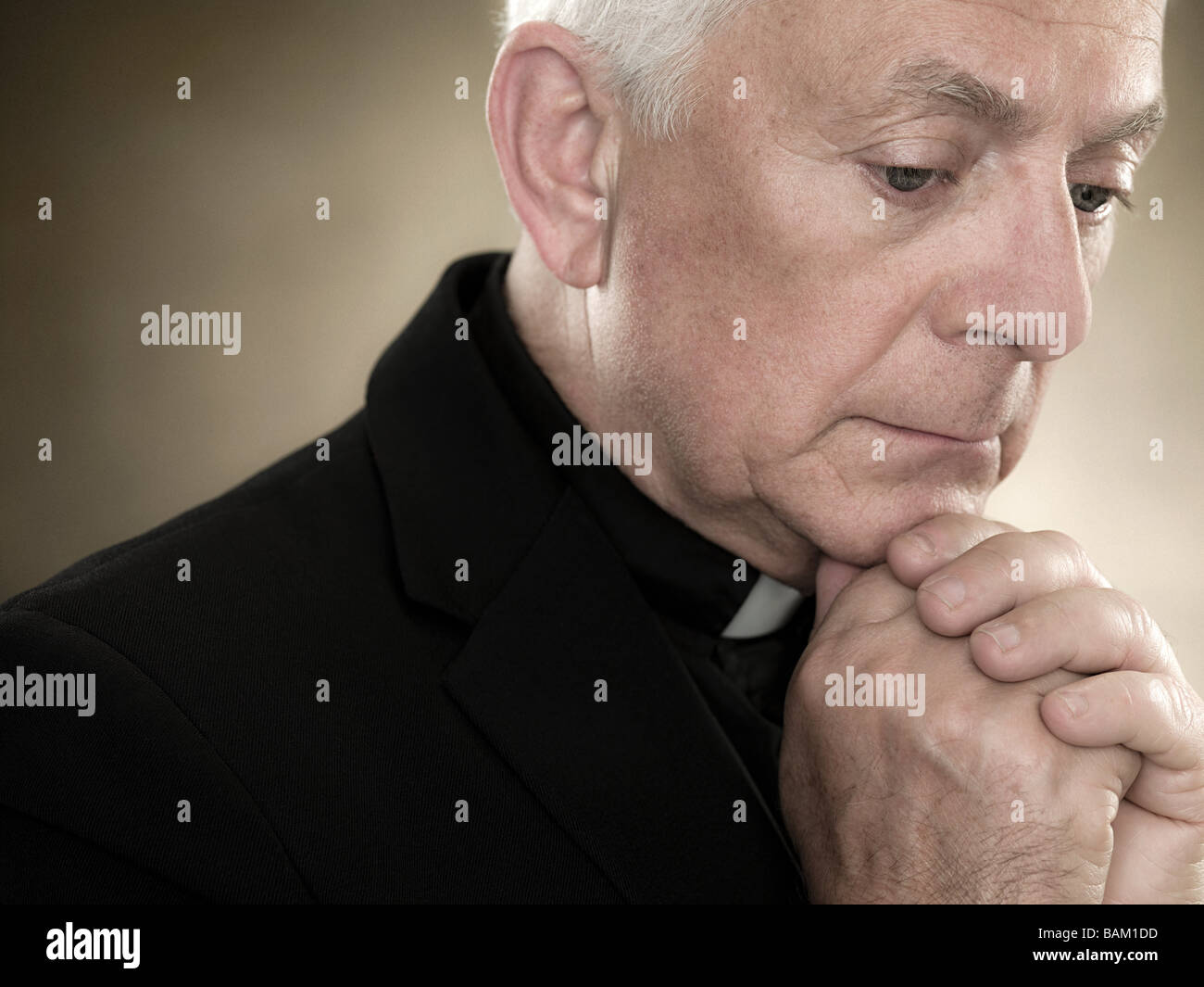 A priest praying - Stock Image