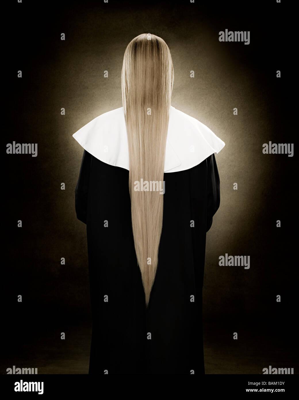 Rear view of a nun - Stock Image