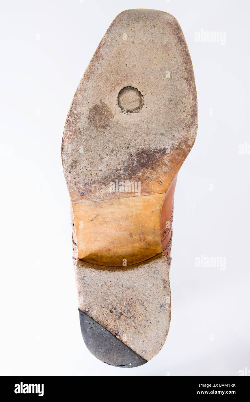 Worn sole of a shoe - Stock Image