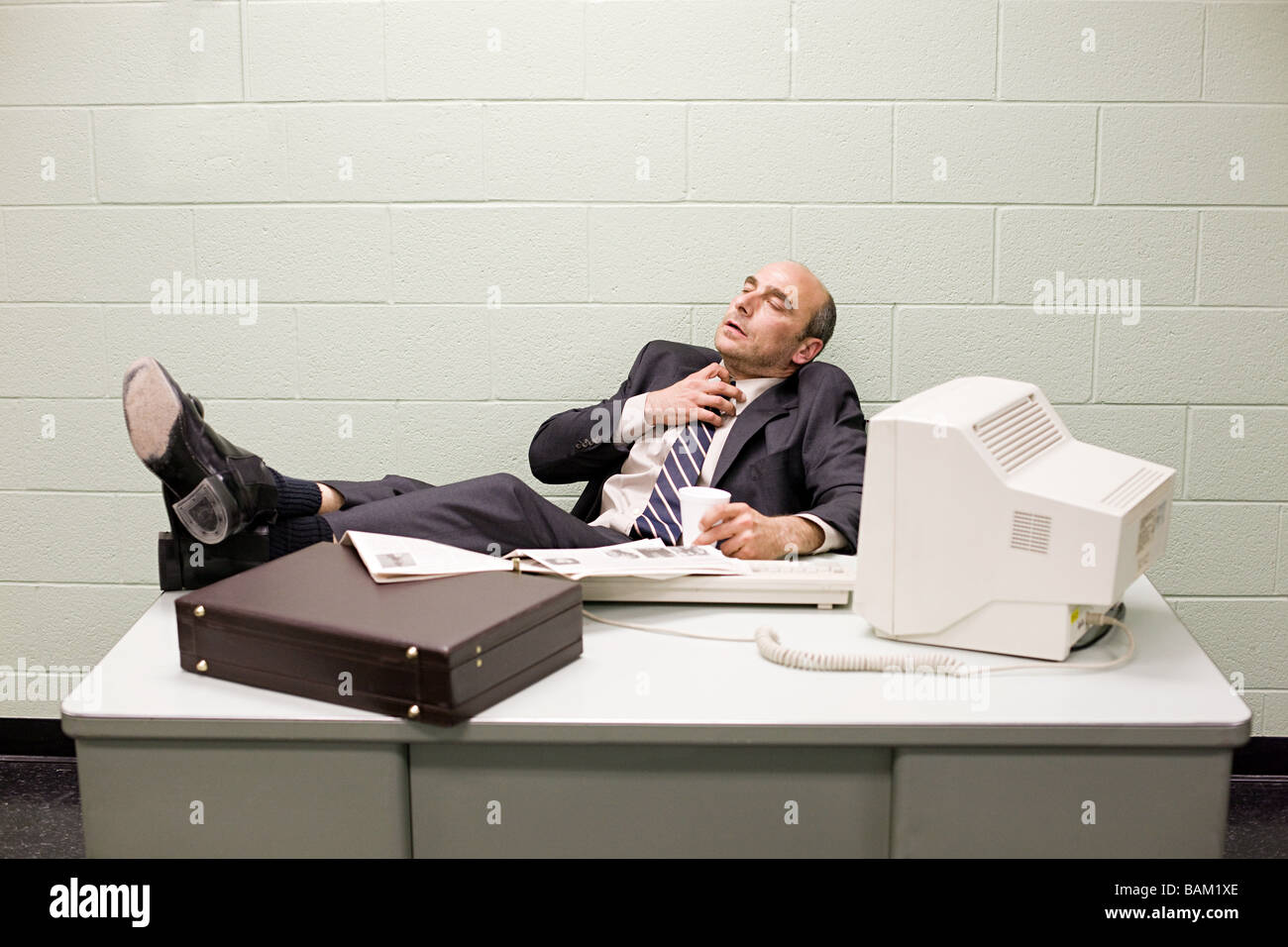 Detective at his desk - Stock Image