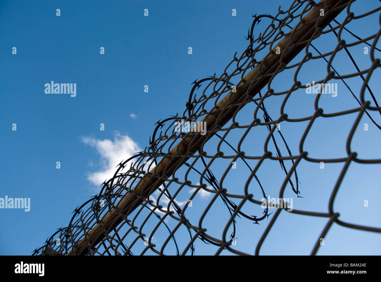 fence razor wire blue sky cloud barrier restraint prevention ...