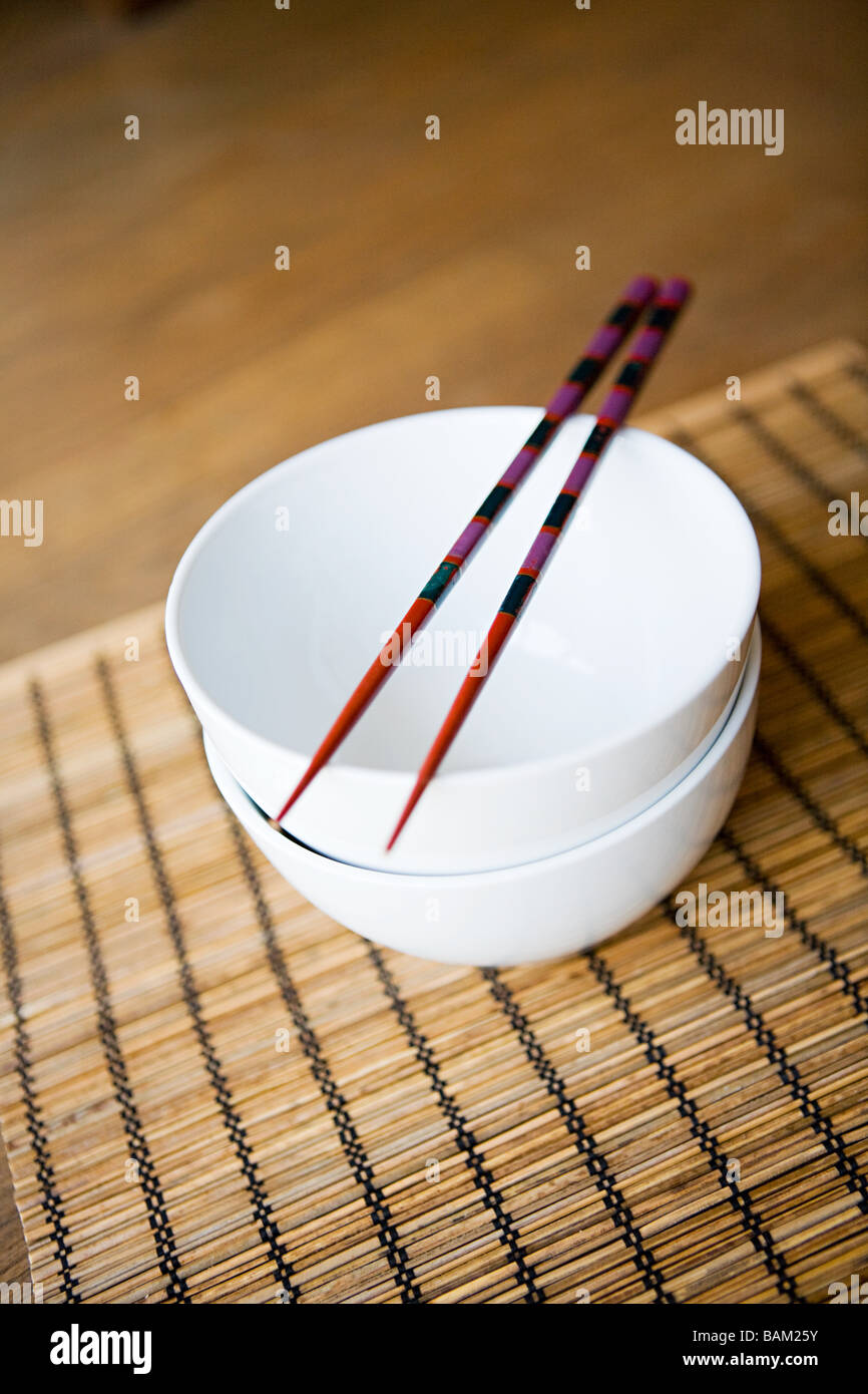 Dishes and chopsticks - Stock Image
