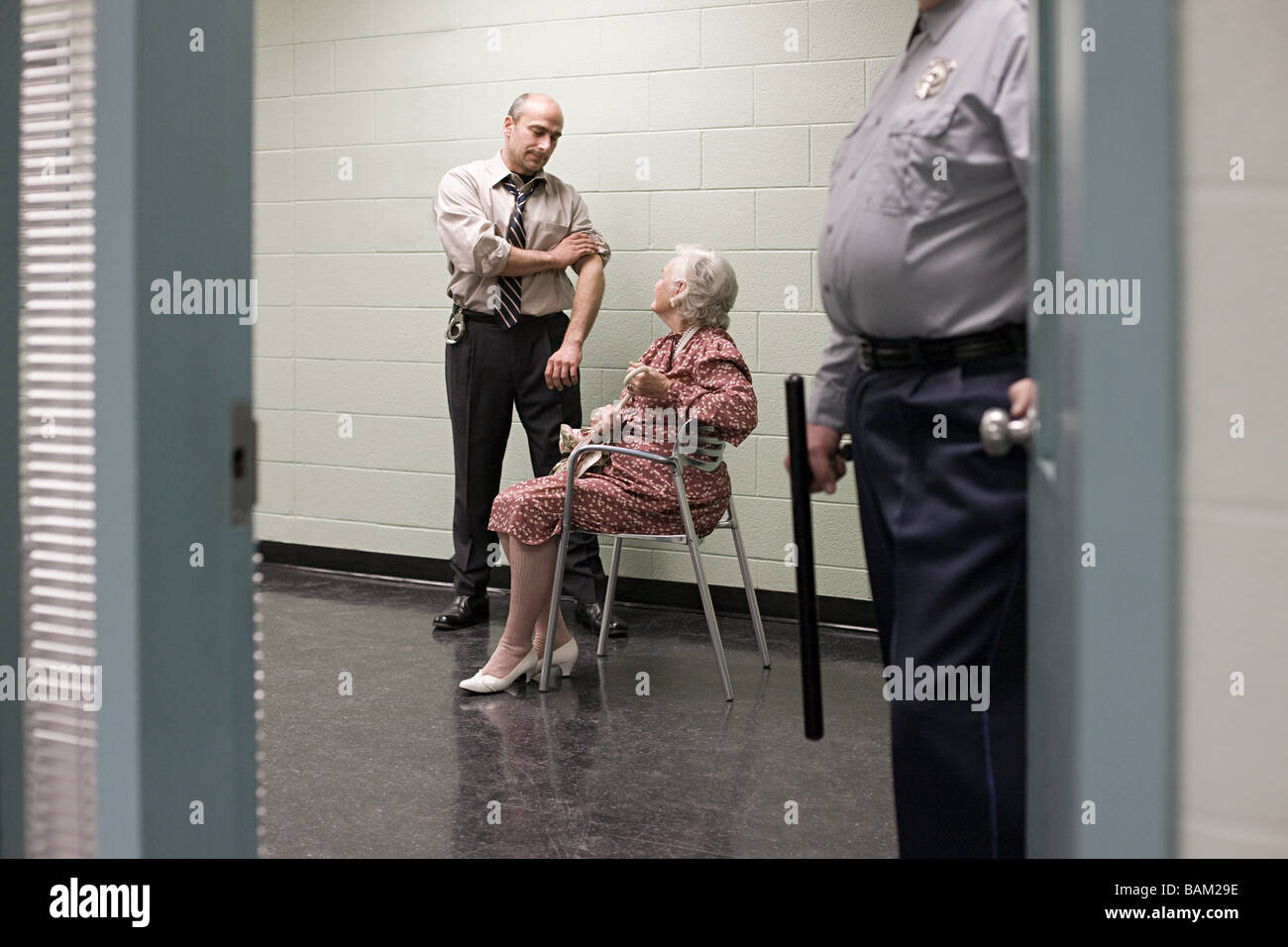 Senior woman being questioned - Stock Image