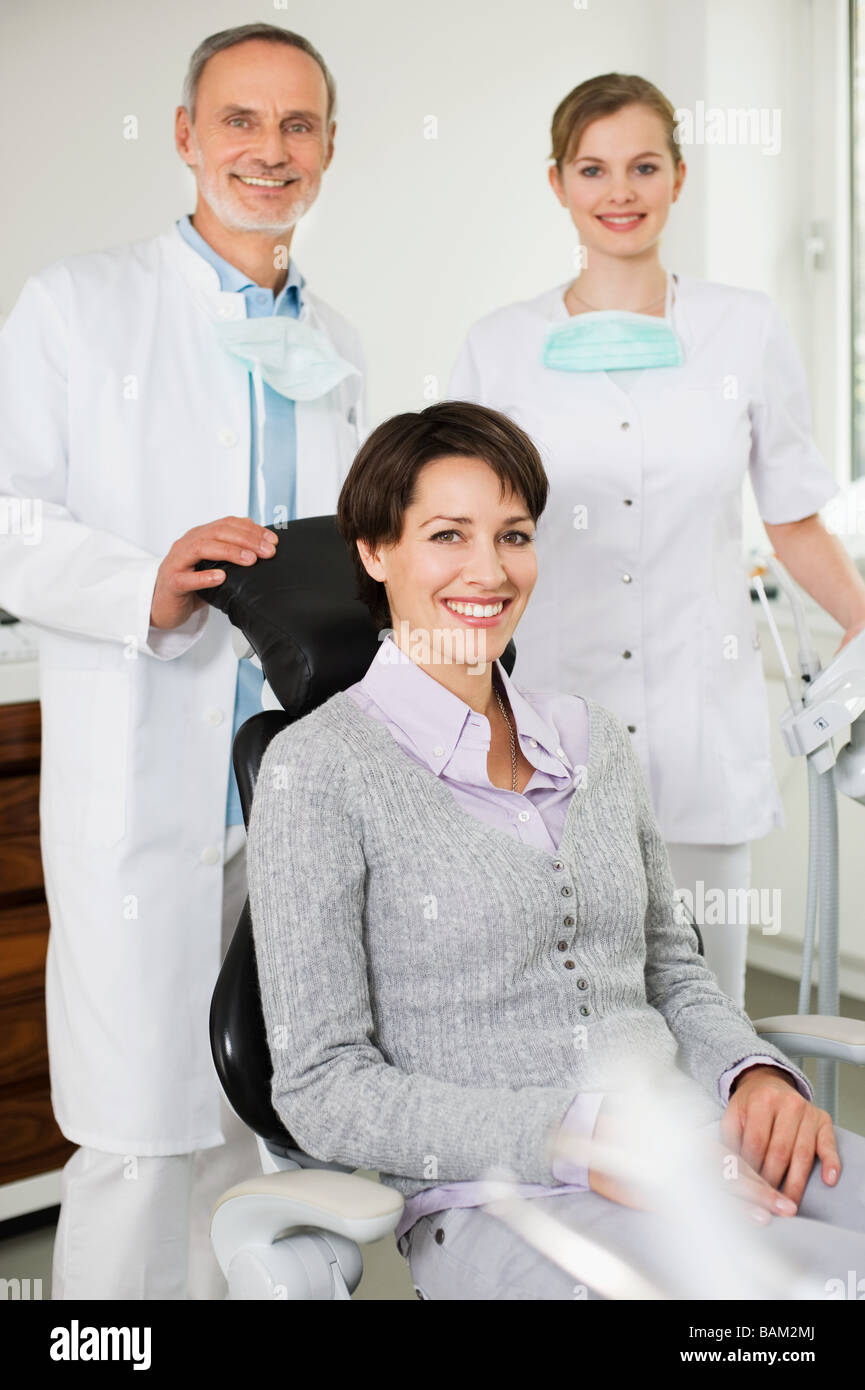 Woman at with dentist and hygienist - Stock Image