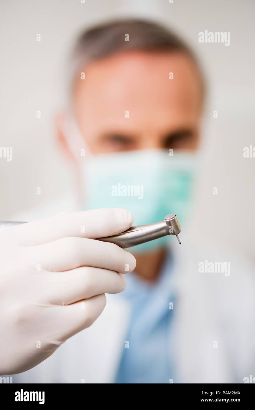 Dentist with drill - Stock Image