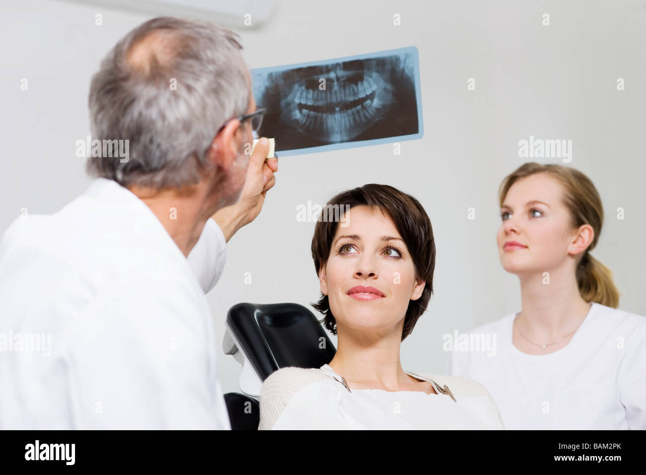 Dentist with patients x-ray - Stock Image