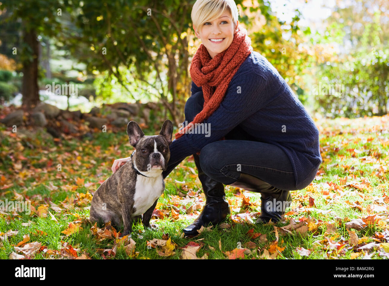 Young woman with pet dog - Stock Image