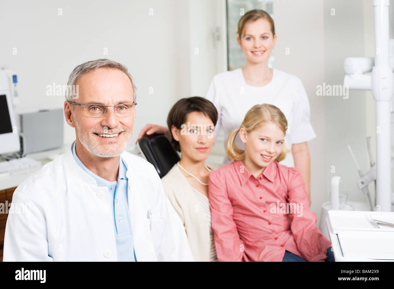 Dentist and patients - Stock Image