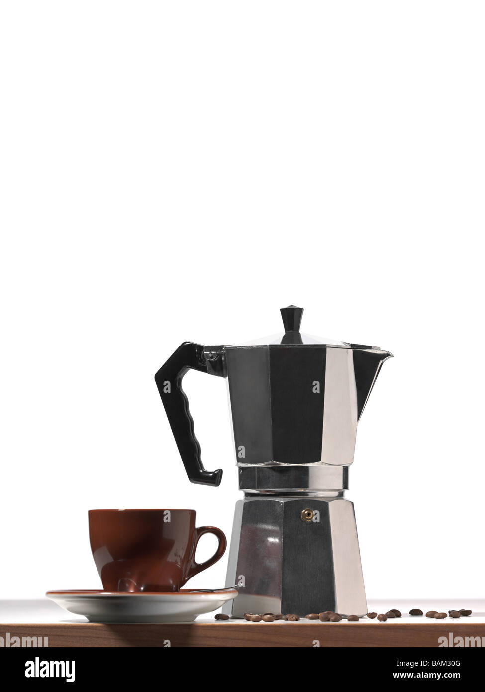 A french press and coffee cup - Stock Image