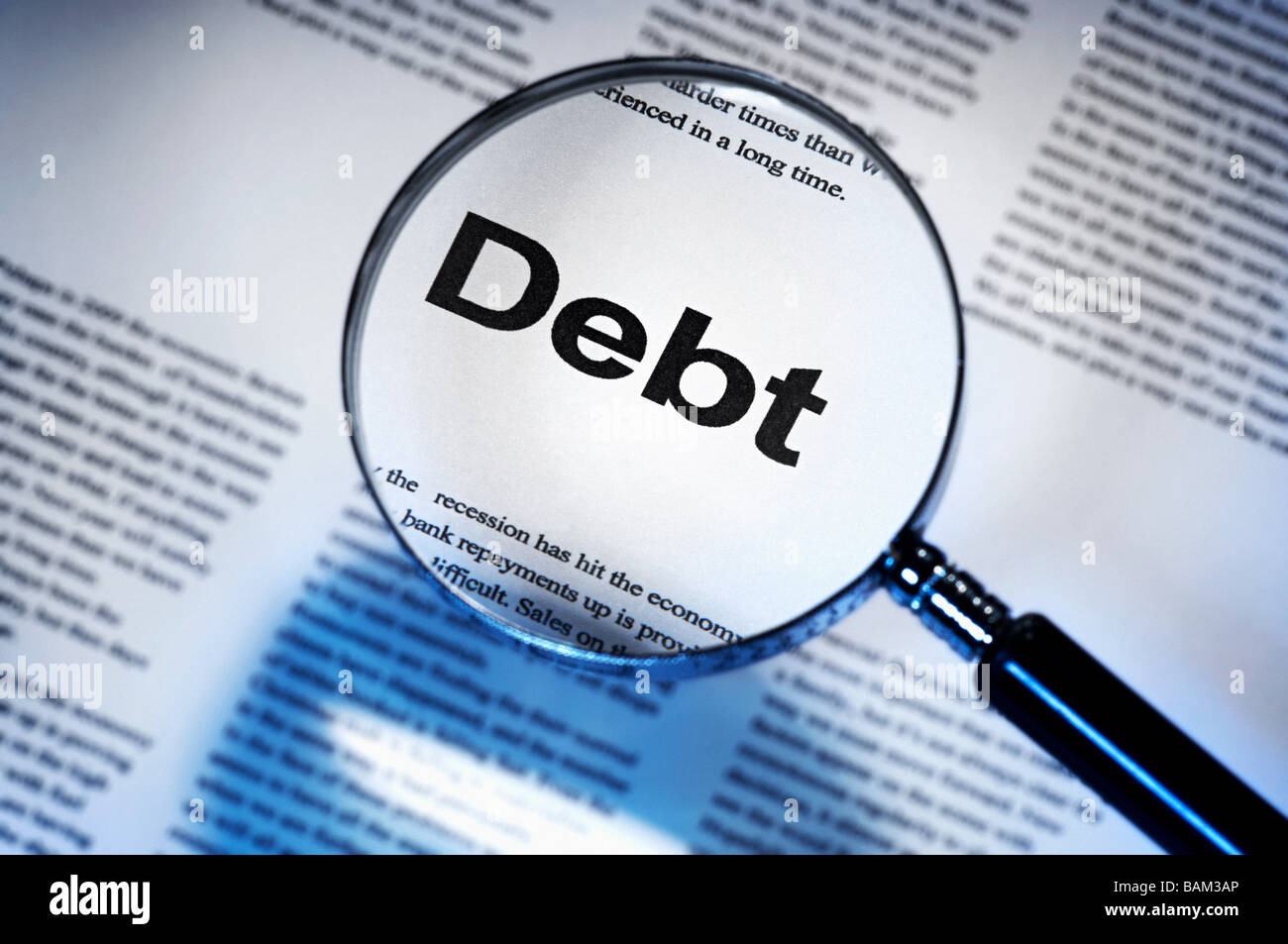 Word debt under magnifying glass - Stock Image