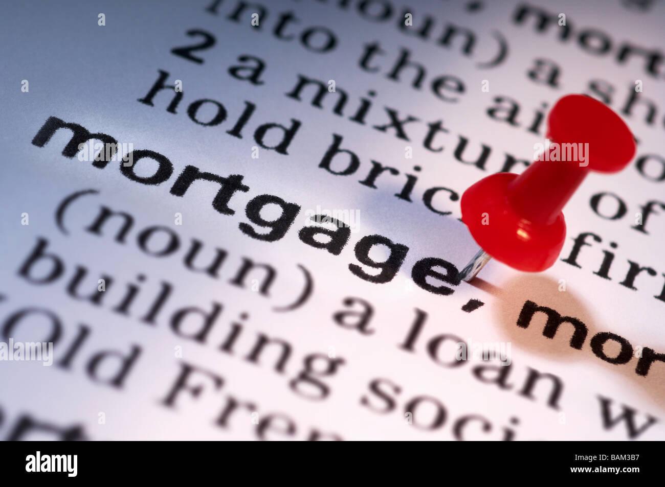 Thumb tack on word mortgage - Stock Image