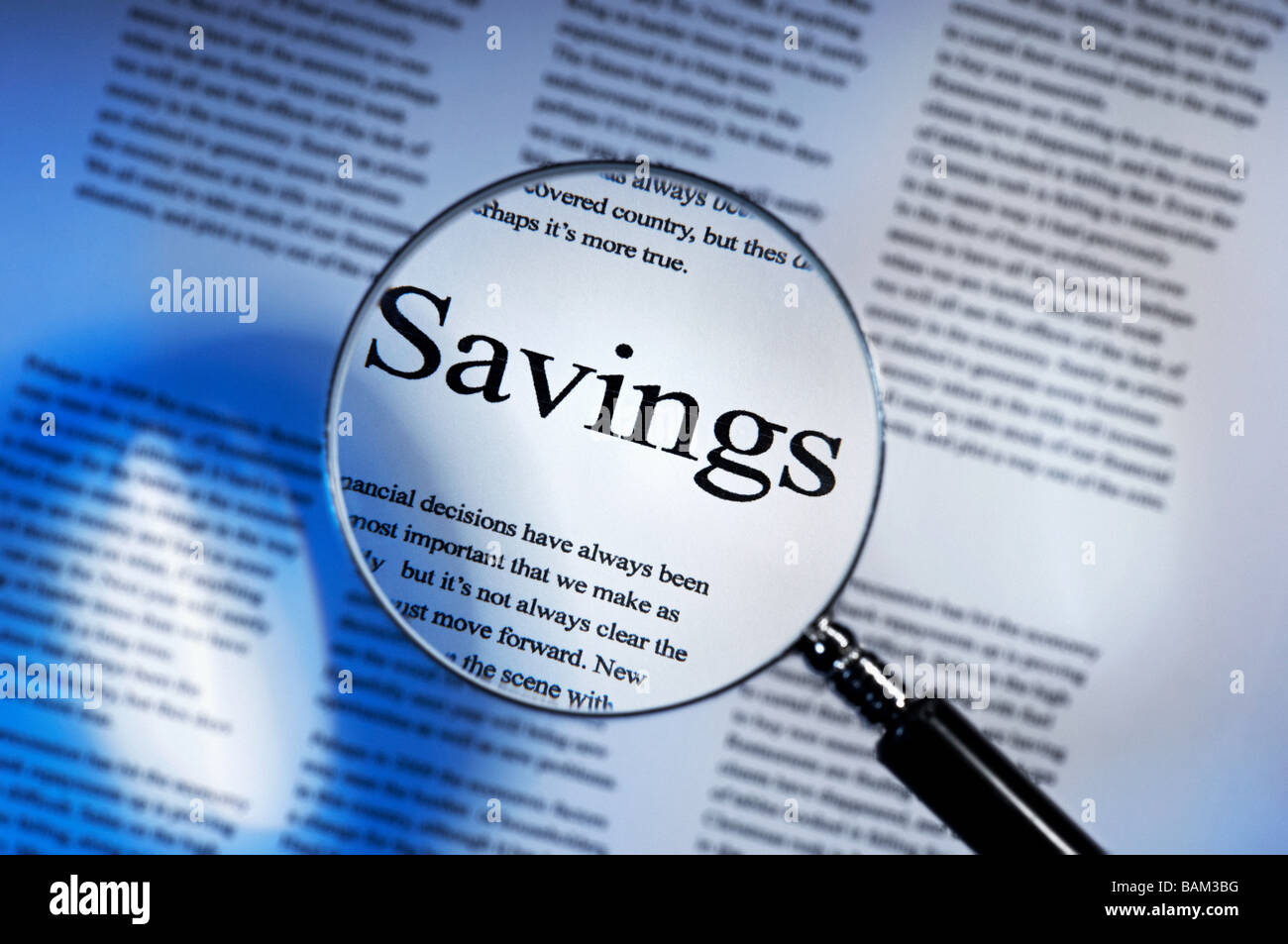 Word savings under magnifying glass - Stock Image