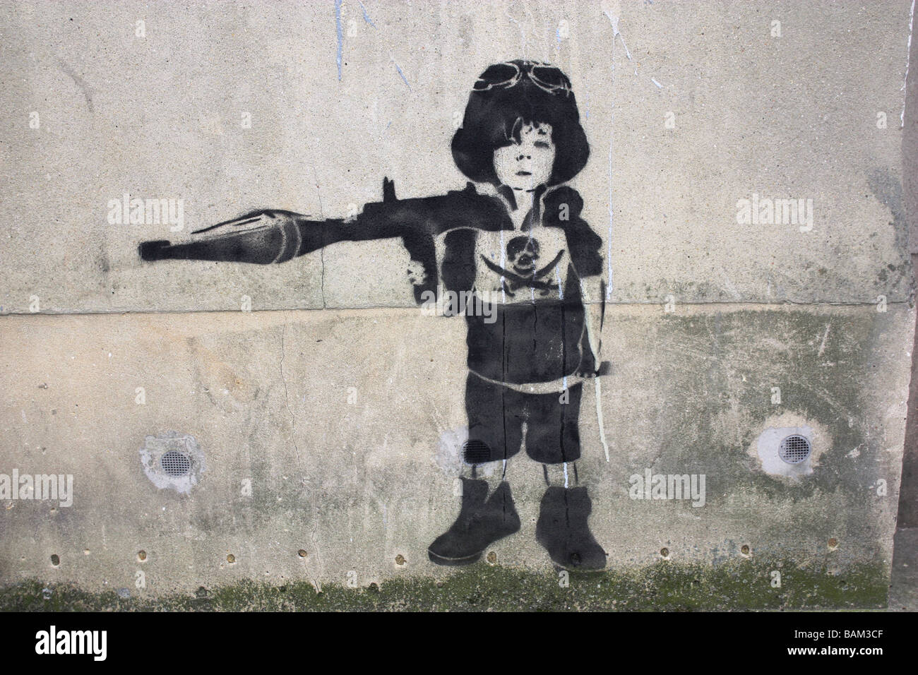 Banksy street art graffiti showing child with rocket propelled grenade