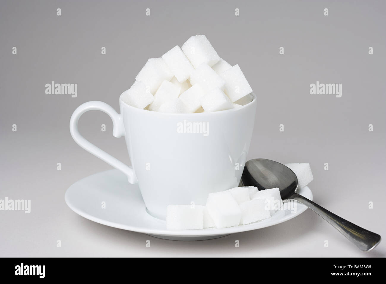 A cup full of sugar lumps - Stock Image