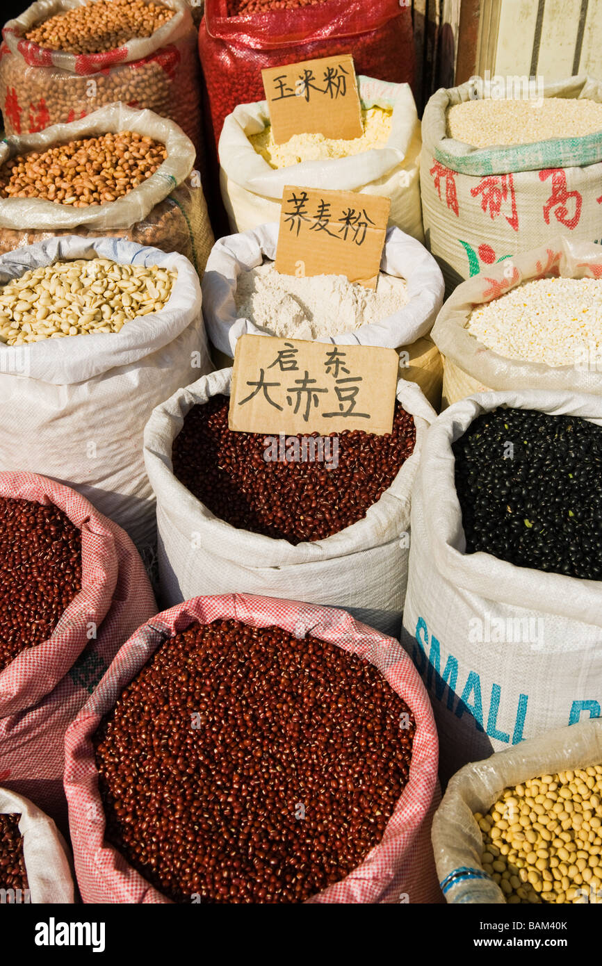 Bags of beans in shanghai market - Stock Image