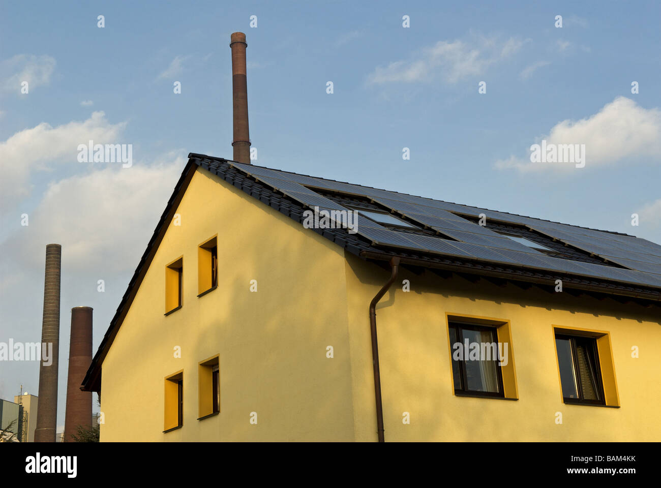 Solar panels fitted to a roof of a house in Germany. - Stock Image