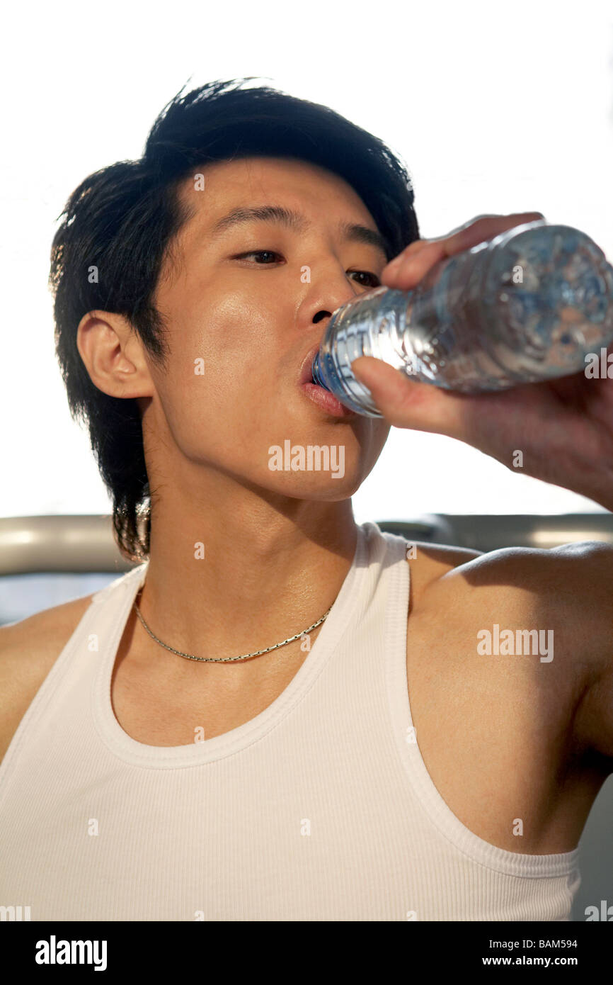 Man Drinking From Water Bottle - Stock Image