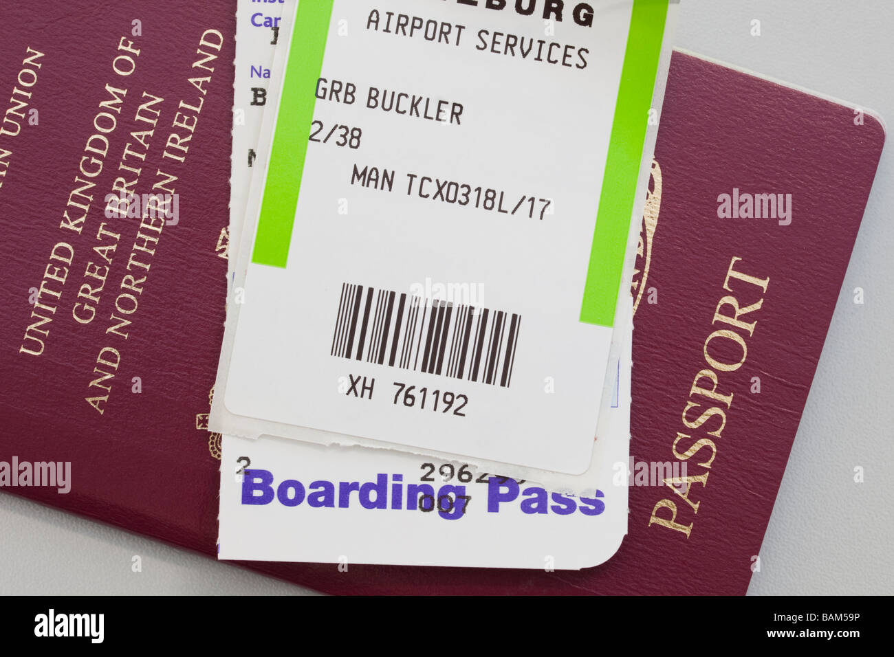 United Kingdom British passport plane flight Boarding Pass and luggage ticket for travel abroad - Stock Image