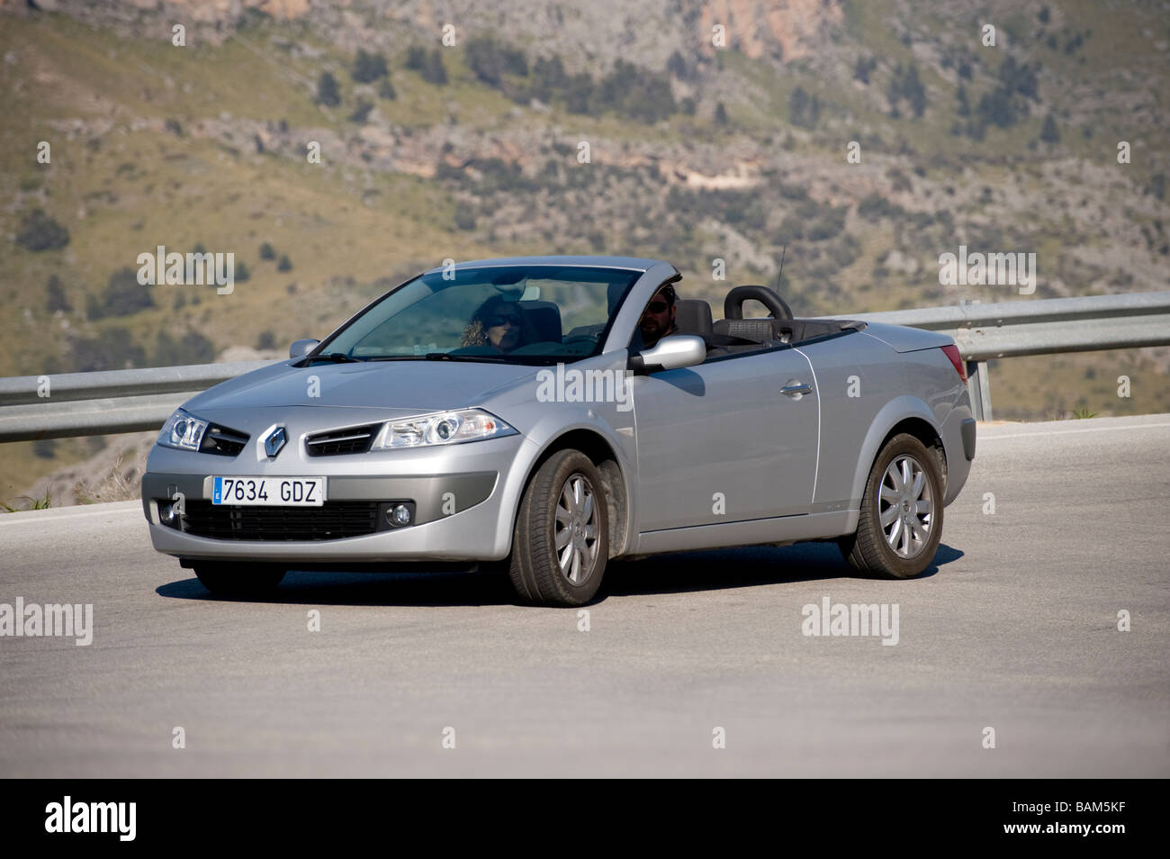 Silver Renault Megane Cc Coupe Cabriolet Being Driven Along A Road In Stock Photo Alamy