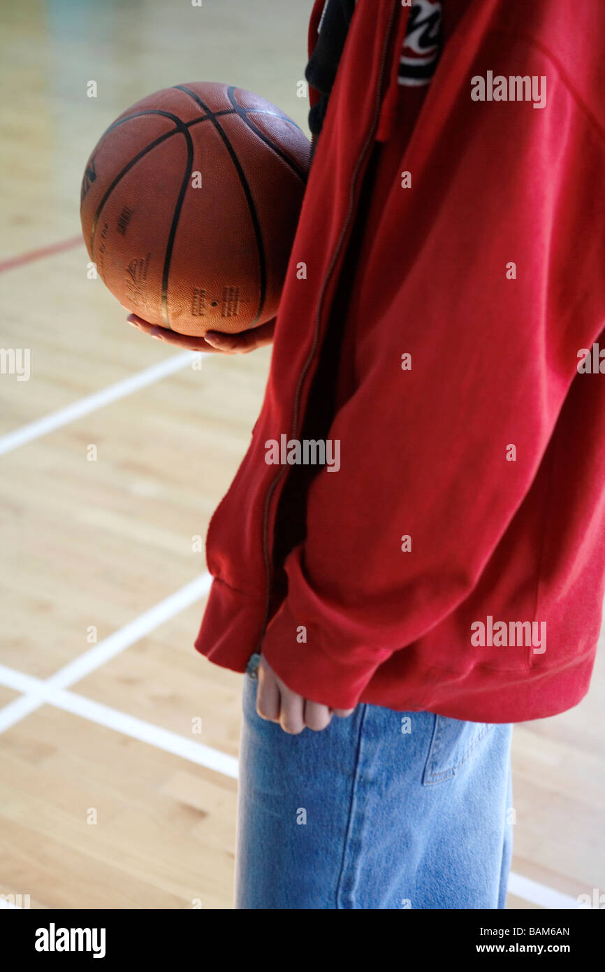 Young Man Holding A Basketball - Stock Image
