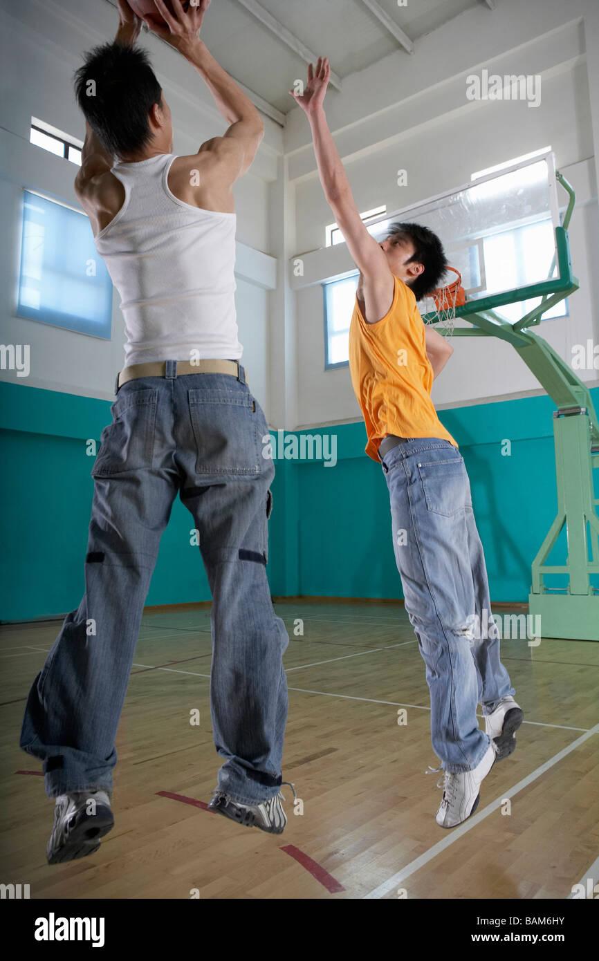 Teenage Boys Playing Basketball - Stock Image