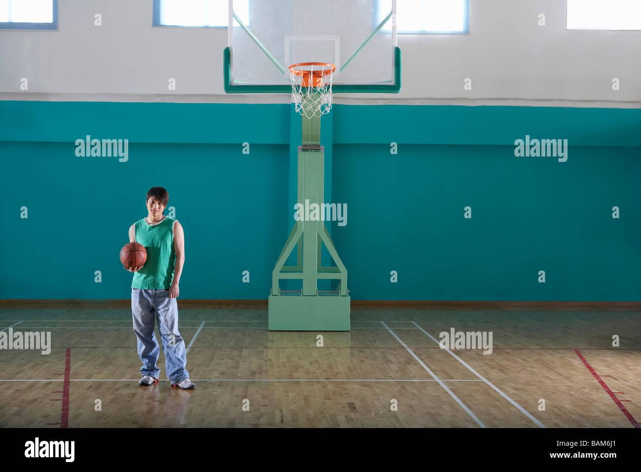 Teenage Boy Holding Basketball - Stock Image