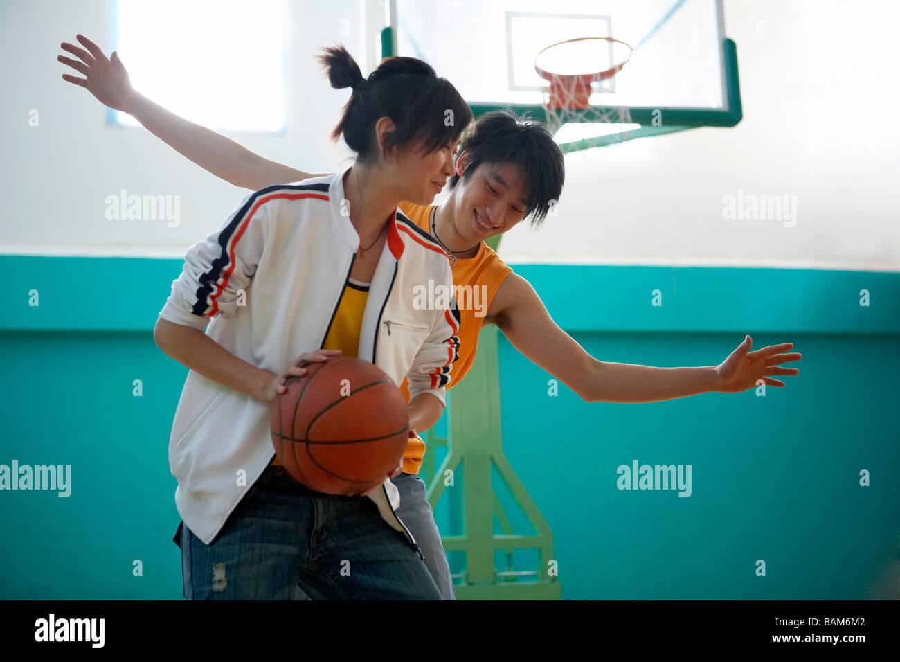 Friends Playing Basketball - Stock Image