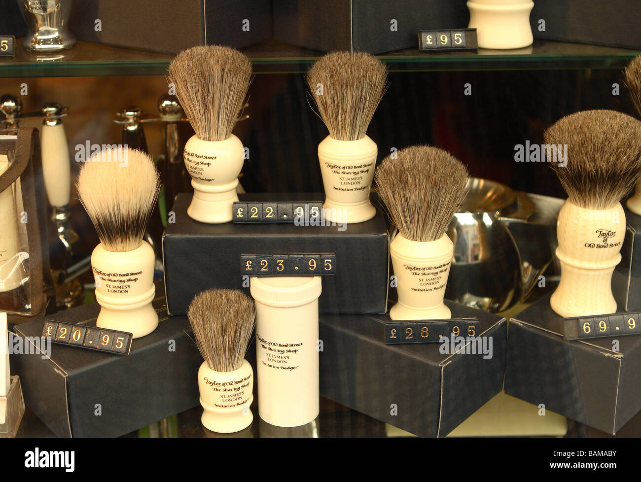 Shaving brushes for sale in window display of Taylor of Old Bond Street store shop in Jermyn Street London - Stock Image
