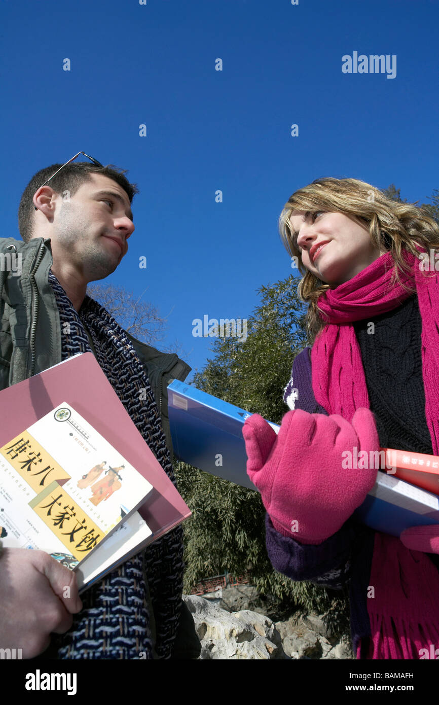 Young People Holding Books - Stock Image