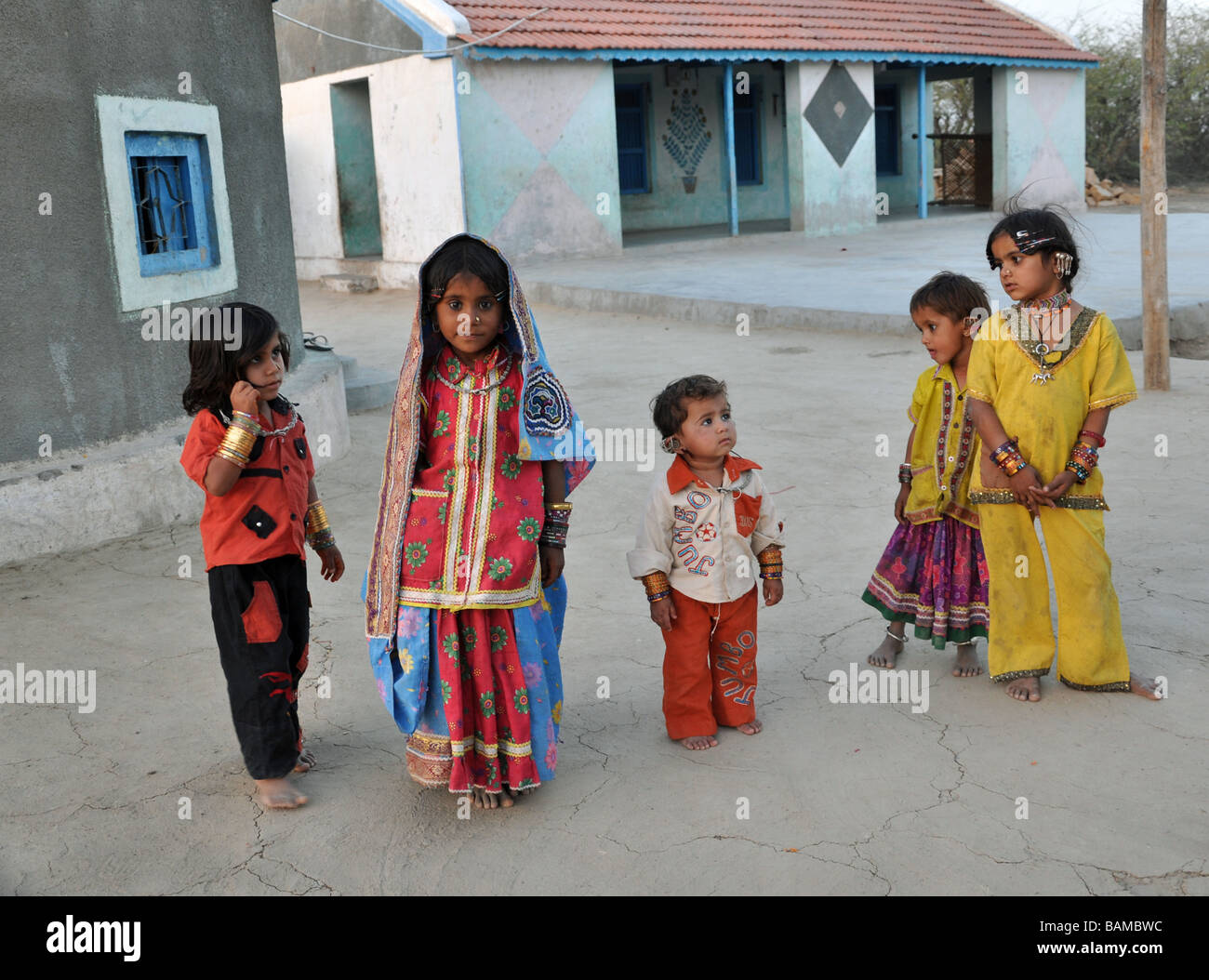 A group of young children wearing beautifully designed and embroidered clothing from the Tribal village of Hodka, - Stock Image