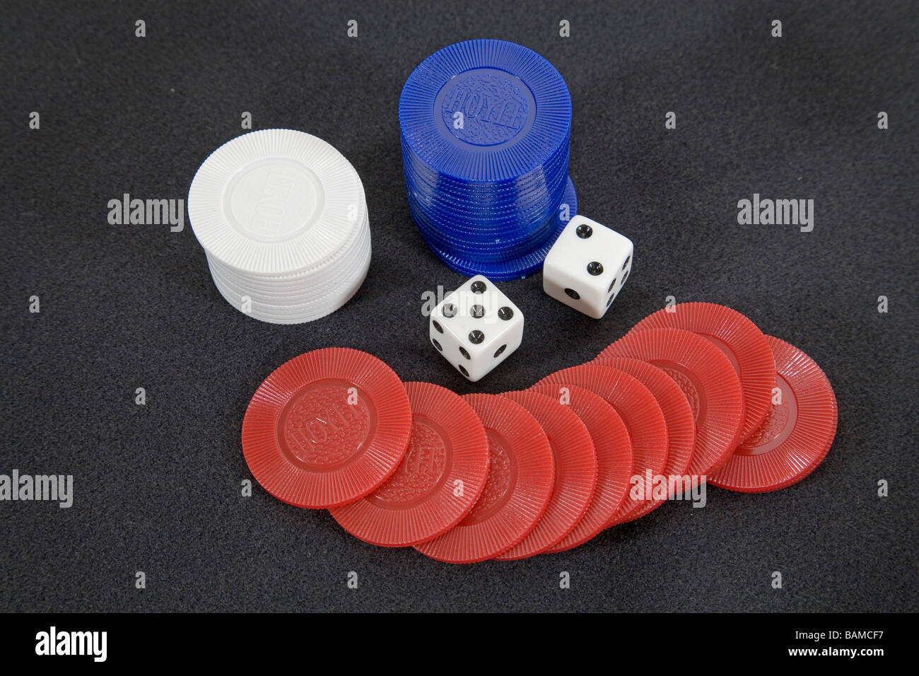 A winner Dice showing a five and a two for a total of seven spots - Stock Image