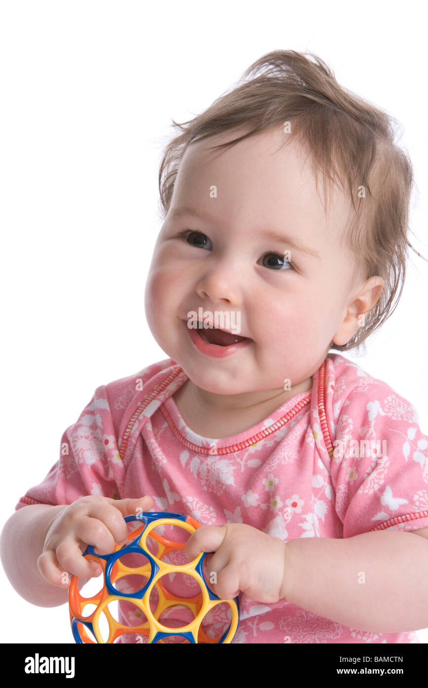 One year old girl with a ball - Stock Image