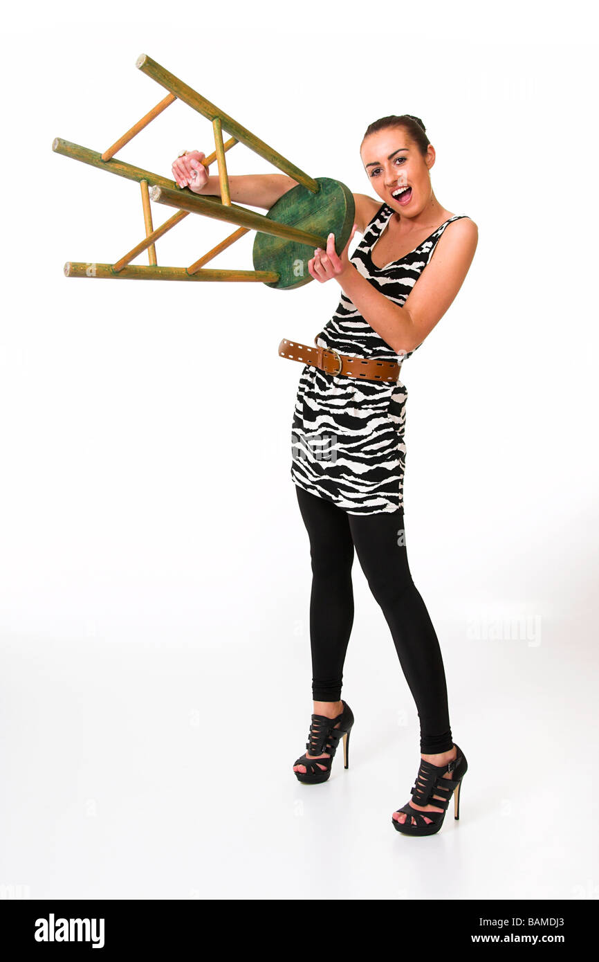 Pretty Girl Holding a Stool Stock Photo