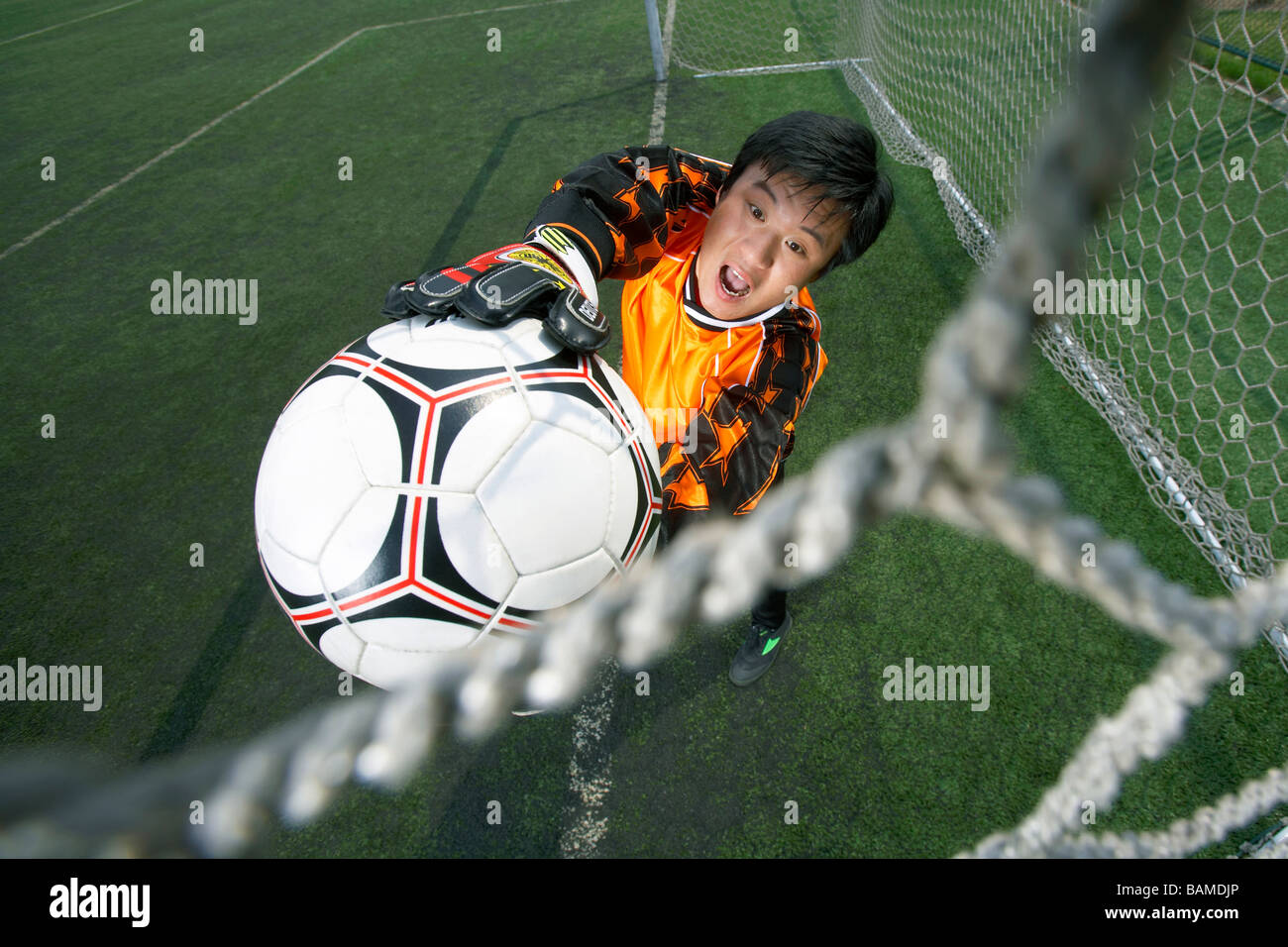 Goalkeeper Catching Soccer Ball - Stock Image