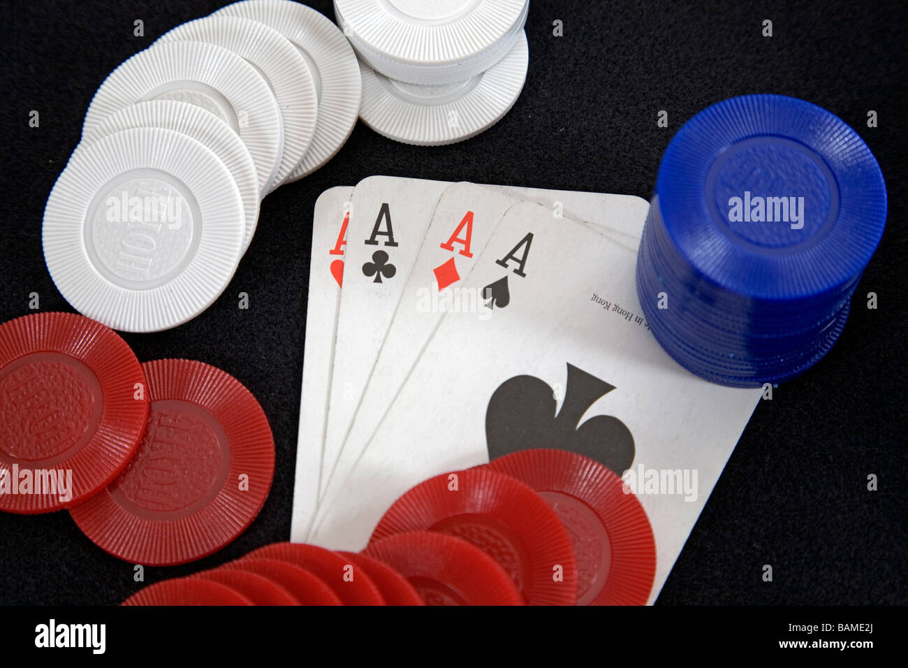Four aces a winning poker hand in draw or stud poker with poker chips - Stock Image