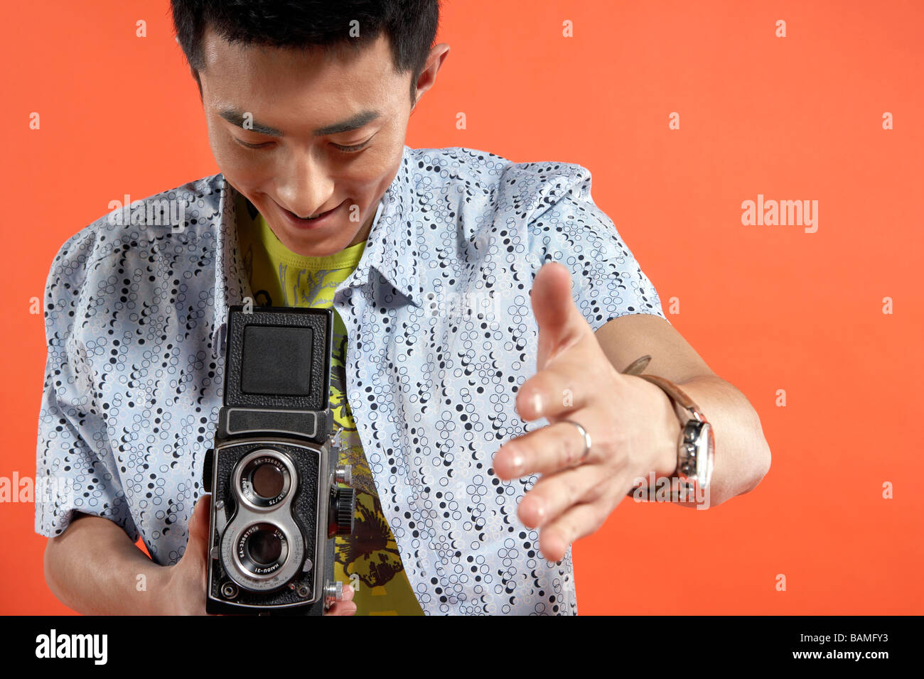 Young Man Holding Vintage Film Camera - Stock Image