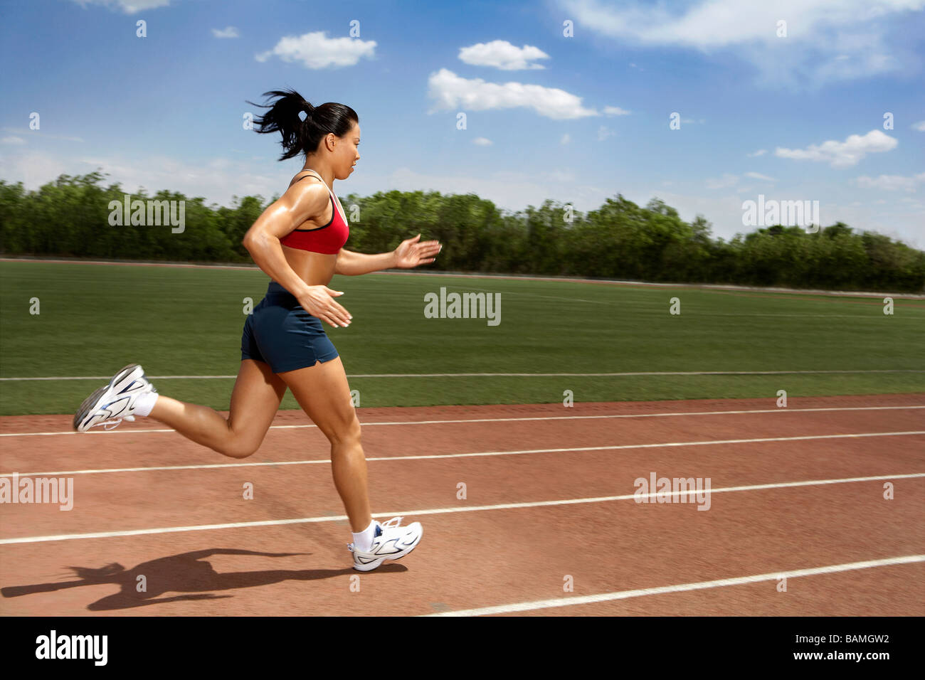 Athlete Running Track - Stock Image
