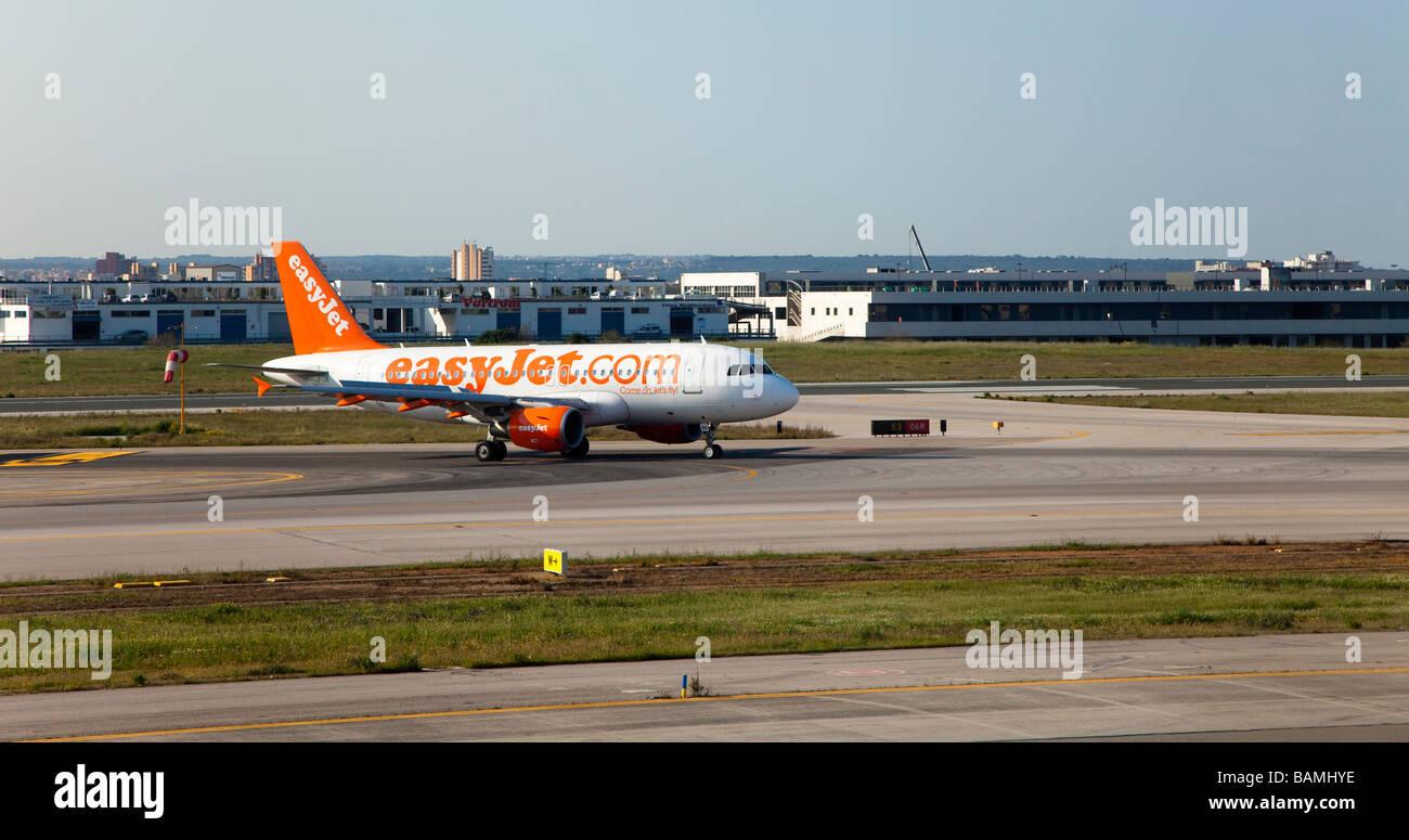 Easyjet aeroplane taxiing on runway Palma airport Mallorca Spain - Stock Image